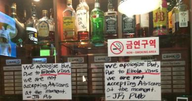 These signs appeared at a bar in Itaewon.